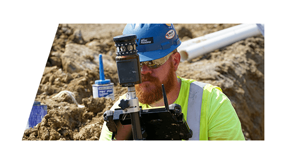 A Ken Neyer Plumbing worker surveying a construction site