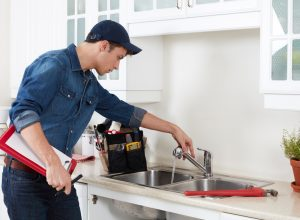 plumber-doing-kitchen-repairs