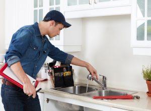plumber-doing-kitchen-repairs