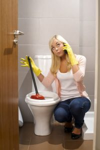 toilet-plumbing-concerned-woman