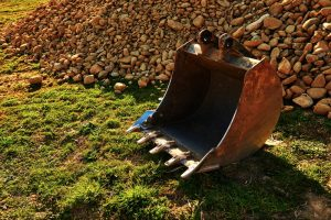 Backhoe-bucket-with-pile-of-rocks